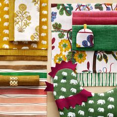 Colorful and patterned dining textiles from Svenskt Tenn. Placemats, napkins, egg warmers and egg holders.