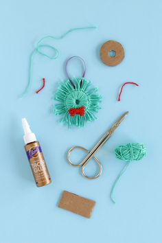 Instructions for how to make a holiday wreath ornament with yarn scraps! Click for the tutorials.