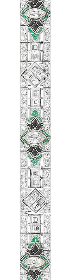 Art Deco Platinum, Diamond, Emerald and Black Onyx Bracelet   The pierced bracelet centering 3 marquise-shaped diamonds approximately 1.25 cts., flanked by fancy-shaped buff-topped cabochon black onyx, edged by rectangular and fancy-shaped emeralds, spaced by 25 square-cut diamonds, set throughout with 116 old European-cut diamonds, diamonds altogether approximately 9.65 cts., circa 1925. Length 6 3/4 inches.