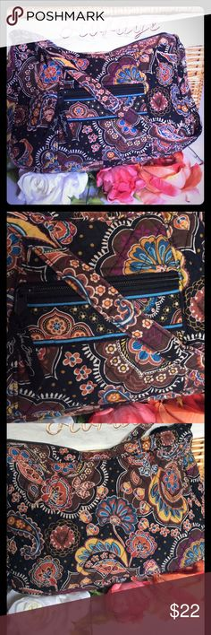 """VERA BRADLEY BROWN BAG VERA BRADLEY BROWN FLOWERED BAG. SIZE IS 7"""" X 12"""" X 3"""". HAS A SMALL ZIP POCKET ON OUTSIDE FRONT. ZIP CLOSURE AND HAS A SMALL POCKET ON INSIDE AND THE REST IS OPENED. CUTE BAG THAT IS IN GOOD CONDITION. Vera Bradley Bags"""