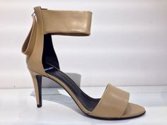 Spring sandals from Pierre Hardy. Tan leather with an adjustable ankle strap and black sole.
