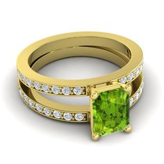 This ring brings two bands and two loves together harmoniously. The two ribbons lift up the center stone between them. Both bands are decorated with gems all the way around.