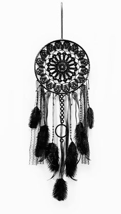 This gorgeous black dream catcher is the largest size and I used a beautiful black crochet new doily. it is completely black.  It contains wooden beads colored in black and black threads in lace.  Size: diameter of the hoop 11 (28cm) length of dream catcher from the point of attachment of the lowest point of the feather 35 (90cm)  Perhaps this dream catcher will hang over your bed.  It may be a beautiful part of the interior of your home.  Maybe you adorn your wedding and with their…