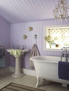 love the wooden planks on walls and ceiling.  Looks great with uber-fem color and fixtures