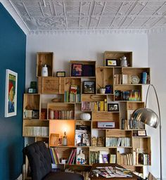 Stacked wine boxes as bookshelves  - A BEAUTIFUL MESS