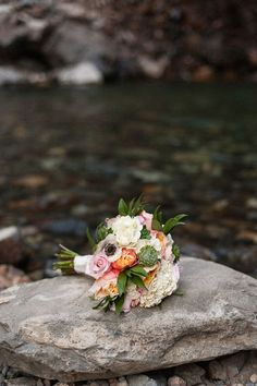 Roses, anemones, succulents, hydrangeas, and greenery make up this beautiful bouquet. | Photo by Autumn L. Rudolph Photography