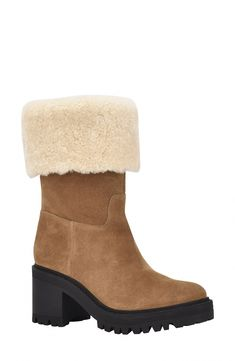 A plush cuff of genuine shearling warms a gorgeous, winter-ready leather boot lofted by a block heel and finished with a lugged, traction-enhancing sole. Style Name:Marc Fisher Ltd Willoe Boot With Genuine Shearling Trim (Women). Style Number: 6115212. Available in stores. #AustralianSheepskinBoots
