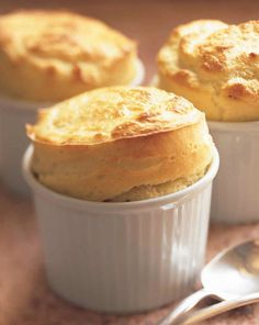 A creamy, flavorful aged goat cheese sauce enriched with egg yolks forms the base of this vegetarian souffle. Beaten egg whites are gently folded into the mixture and the souffles are baked until golden and fluffy. Cheese Souffle, Souffle Dish, Souffle Recipes, Flan, Tapas, Goat Cheese Recipes, Cheesy Recipes, Food Dishes, Cooking Recipes
