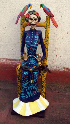 Catrina de Frida Kahlo sentada.