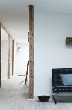 Hallway with old wooden beams. Fredgaard Penthouse by Norm.Architects