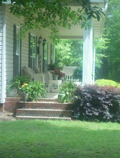 My front porch. I like the side stairs leading to the yard