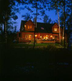 Log homes look so beautiful lit up at night. www.hiawatha.com