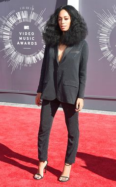Solange from 2014 MTV Video Music Awards Red Carpet Arrivals  Solange arrived looking fab in a glittering black pantsuit and—if you look closely—you'll notice her blue nails.
