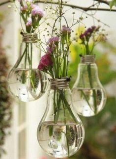 Lightbulb vases for a #vintage feel. #weddings #decor