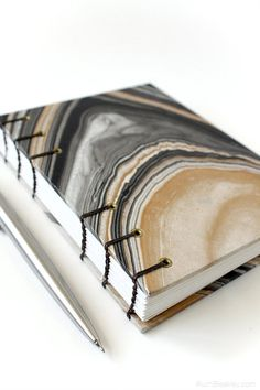 Coptic Stitch Journal with Black and Gold Marbled Paper (the paper reminds me of an agate!) by Ruth Bleakley