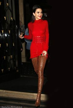 Scarlet siren: Kendall Jenner looked absolutely incredible in a red knitted dress and a sexy pair of thigh-high boots as she ventured out in Paris on Friday night