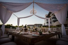 Host a romantic and intimate reception at Dreams Playa Mujeres Golf & Spa Resort in the Cove Terrace! #FairyLights #ReceptionInspo #ReceptionDecor #PampasGrass