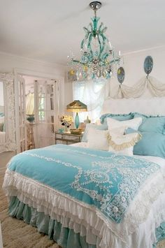 Pretty Turquoise bedroom. I love the chandelier!
