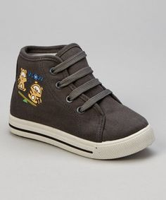 Perfect for playtime, this classic hi-top decked out in cute cartoon raccoons is nonstop sweet fun.