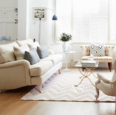 Lliving area of Isabel and George Blunden London renovation, Traditional sofa with plumped up cushions | Remodelista