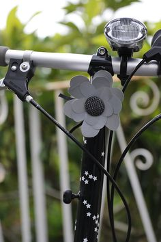 Reflective flower for my bike.  Looks easy enough to try to make.