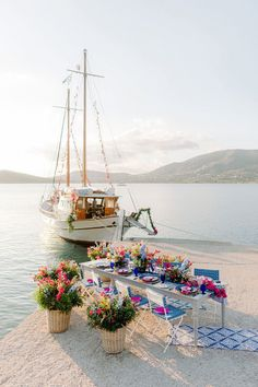 This Greece sailboat elopement is bursting with vibrant colors, pattern play and climbing bougainvillea in the most epic boat party we have seen since the Dancing Queen scene in Mammia Mia. If you love custom heraldry, whimsical motifs or modern romantic table settings, head over to Ruffled Blog to see this destination wedding along the Aegean Sea in all its glory! #sailboatwedding #greeceelopement #bougainvilleamood