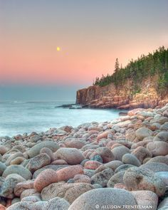 Fine art landscape photography print of a moonrise over round rocks on the coastline at Acadia National Park, Maine by Allison Trentelman.