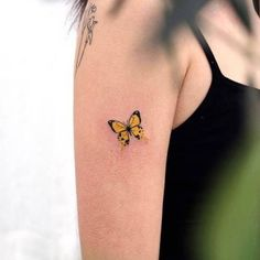 Yellow butterfly tattoo on the right upper arm. - Yellow butterfly tattoo on the right upper arm. Yellow Butterfly Tattoo, Yellow Tattoo, Butterfly Tattoo Designs, Monarch Butterfly, Upper Arm Tattoos, Leg Tattoos, Body Art Tattoos, Tattoo On, Piercing Tattoo