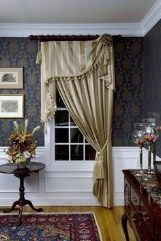 The asymmetrical part of this drapery idea makes this classic window treatment look beautifully unique.