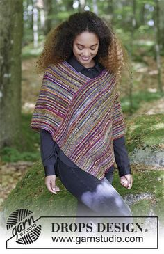 Knitted poncho with garter stitch and stripes. Sizes S - XXXL. The piece is worked in DROPS Fabel.
