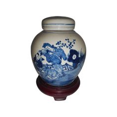 "Our Chinese 6"" high blue and white lady ginger lid jar makes an worldly statement in any room. This collectible jar with lid is hand painted with a lady dancer and floral pattern in blue cobalt glaze.  An antique finish and blue line borders enhance its uniqueness.   http://www.orientalfurnishings.com/hand-painted-blue-and-white-chinese-porcelain-ginger-jar/"