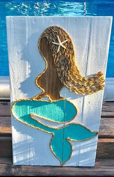 This beachy piece of art is made from reclaimed pallet wood and is perfect for a nautical inspired beach house! Each sign is hand cut, hand sanded, and hand painted. Back ground wood is stained #ad