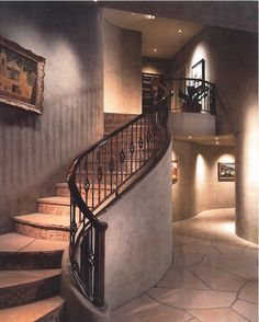 Romantic and subtle curves define the stairway in this Candelaria Design home.
