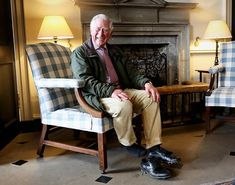 Returning from his afternoon walk around the grounds of Dumfries House in Scotland, The Prince of Wales takes his walking-boots off in the hallway of the Palladian Country House - Known In Scotland as the Duke of Rothesay