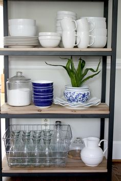 Open shelving, industrial bookcase, blue and white dishes, kitchen storage