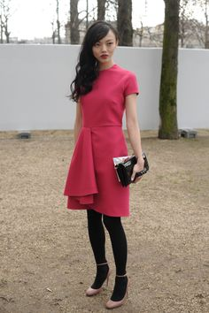 Rila Fukushima wears a Valentino dress from the Pre-Fall 14/15 collection and Valentino Garavani bag and shoes to the Valentino Fall Winter 14/15 Fashion Show, March 4th, 2014, Paris.