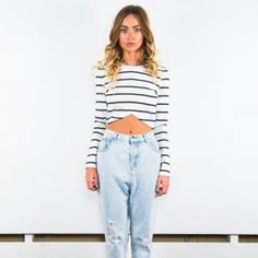 "The Fifth || White Stipe Long Sleeve Crop Top THE FIFTH LABEL PAPERBACK LONG SLEEVE STRIPED TOP   The Fifth Label Paperback Long Sleeve Top is a striped crop from their collection The Warehouse. Featured in a White with Black Stripe, the Paperback Long Sleeve Top also features a inverted hemline, cropped cut, crew neck and comes in a soft jersey. Designer carried by Nasty Gal.  SIZING:  Sizing: S (2-4), M (6), L (8), XL (10) Large: 20"" Length , Bust 36"", Waist 30"", 24"" Sleeve Length (fits…"