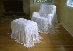 .DIY...no instructions... Has to be similar to the little ghosts using gause / cheesecloth and liquid starch.  Cover the chair with plastic wrap (to prevent damage and to be able to remove it). dip lengths of cheesecloth into liquid starch and squeeze out most of it.  Put layers of  the cheesecloth over the chair. allow to dry and remove carefully.