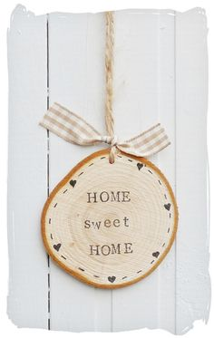 """What a beautiful """"Home sweet home"""" sign! You could try to prepare something similar; just get our wooden log slice door sign and paint. More DIY inspiration available at www.craftmill.co.uk"""