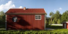 This is a red simple house with number 2 on the side with minimal design. New red house, empty terrace and woods, forest, pine trees in the background. Gravell path to link to the storage. Nice clear sky on top. bushes as fence. Cute Little Houses, Swedish Style, Clear Sky, Number 2, House In The Woods, Minimal Design, Simple House, 2 In, Empty