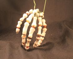 Skeleton Hands - A pair of realistic looking skeleton hands will always come in handy when prop building.  The problem is, they're usually accompanied by the price tag of a bucky skeleton.  So if I told you that you could make a pair of skeleton hands yourself shaped in the position of your choosing for the cost of a few beads, coat hanger, and milk jugs, you'd say I was crazy, right?  Well Gary Benson would beg to differ, because the tutorial he posted at Proprageous will give you…