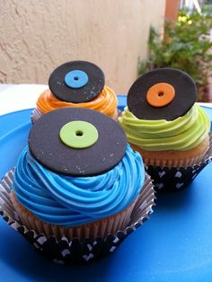 KC - I've ordered fondant cake toppers and decorations through etsy a few times, and always zoo yummy and cute!   Fondant Cupcake Toppers    - 1 Dozen Fondant Vinyl Records  - 4 orange, 4 green, 4 blue  - Approximately 1 1/2 inches diameter    I can make any color