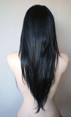 Dark hair and pale skin.