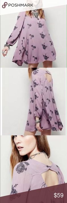 Free People Swing Tunic Dress Never worn without tags. Flowy, bohemian style Free People Embroidered Swing Tunic Dress. Elastic band at bust and cuffs. Deep 'V' in back. Lined. Size Small. Color: Elderberry. 100% Rayon, Lining: 60% Rayon, 40% Cotton. Hand Wash Cold. Free People Tops Tunics