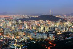 Seoul, South Korea - see the Seoul Tower on that little hill in the background? I climbed that hill in 1990 to see that tower. It was paved, no problem. We were within walking distance of our hotel and shopping in E-Tae-Won (spelling???)