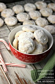 PEPPERMINT SHORTBREAD COOKIES are little bites of Christmas-y heaven! Melt-in-your-mouth shortbread cookies are studded with peppermint candy pieces and then covered in powdered sugar.
