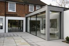 Rear extension with minimal windows sliding doors and fixed frameless glazing - October 05 2019 at Extension Veranda, House Extension Design, Extension Designs, Glass Extension, Roof Extension, House Design, Bungalow Extensions, House Extensions, Windows