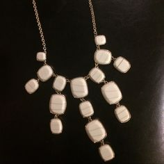 Nine West White Statement Necklace Beautiful on a black blouse! Great statement piece for that LBD. Quality made necklace. Worn a couple times. Never worn. Add to one of my fabulous tops or another piece of jewelry for 15% off both with my bundle option! Nine West Jewelry Necklaces