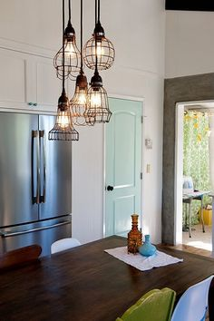 wooden door refrigerator dining table blue stool chair hardwood floor. Black Bedroom Furniture Sets. Home Design Ideas