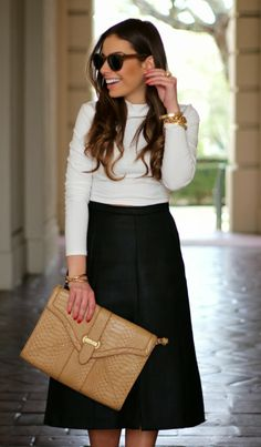 outfit of the day wearing oversized nude clutch, black a-line skirt and white turtleneck